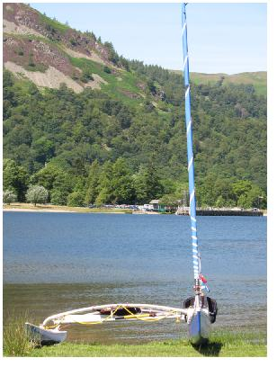 This photo, taken during the Open Canoe Sailing Group's Lakes Classic Meet on Ullswater in July 2009, is a front, end-on view of my Raptor, showing the very narrow, low volume hulls. This was a pleasant picnic spot with Glenridding Pier in the background.